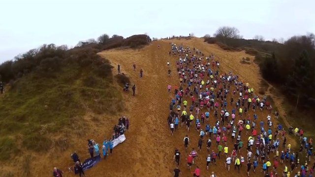 "Runners going up ""The Big Dipper"" sand dune"