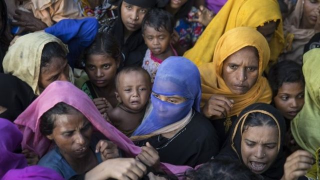 Desperate Rohingya grab for aid handouts of clothing and food on 15 September 2017 in Tankhali, Bangladesh.