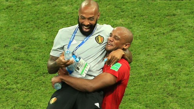 Thierry Henry celebrates Belgium's victory over Brazil with Vincent Kompany on 6 July