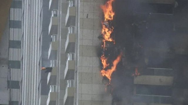 Flames on side of building