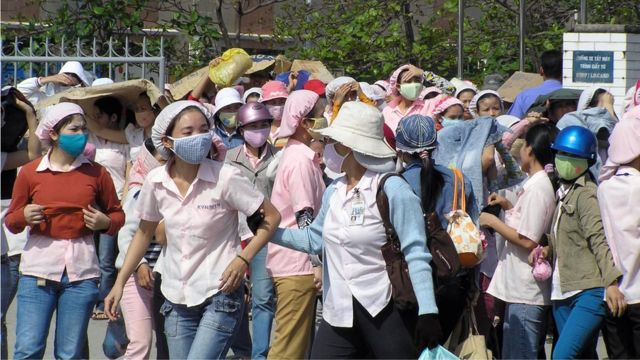 Vietnamese workers are seen as they go on strike at the Keyhinge Toy plant in the central city of Da Nang, 30 January 2008