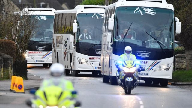 A convoy of coaches carrying British evacuees from Wuhan travel