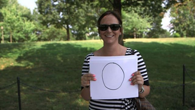 An American teacher posing with the number of vacation days she had last year