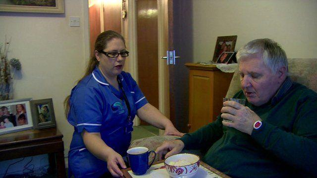 Care worker helps an elderly man