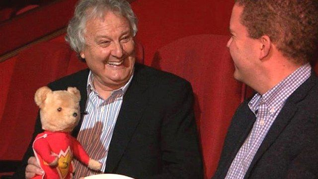 Mike Young with a SuperTed toy