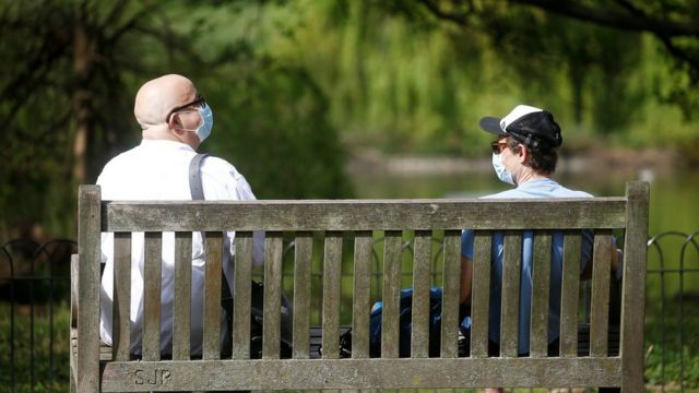 """Two men wearing a protective face mask are seen in St James""""s Park, as the spread of the coronavirus disease (COVID-19) continues, London,"""