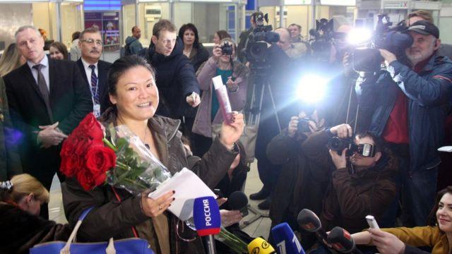 Ли Ен в аэропорту
