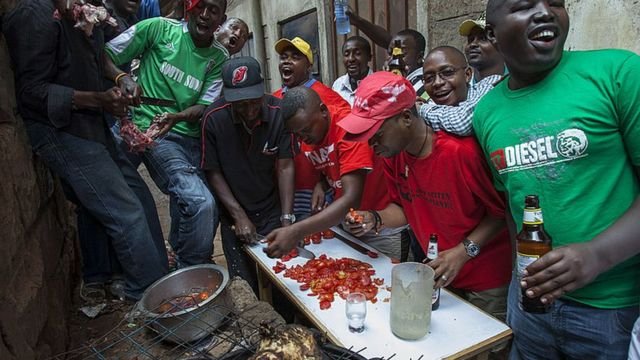 People in Nairobi preparing a meat barbecue