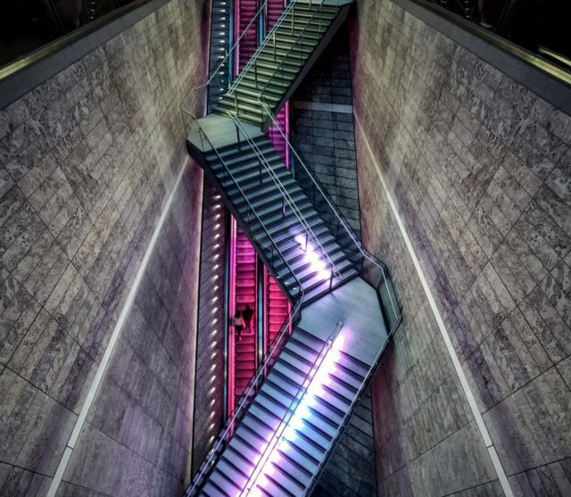 Suspended stairs and an escalator