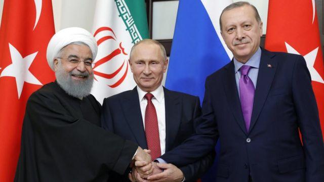 الرئيس التركي رجب أردوغان والرئيس الروسي فلاديمير بوتين و الرئيس الإيراني حسن روحاني