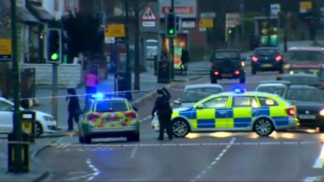 Police cordon and vehicles