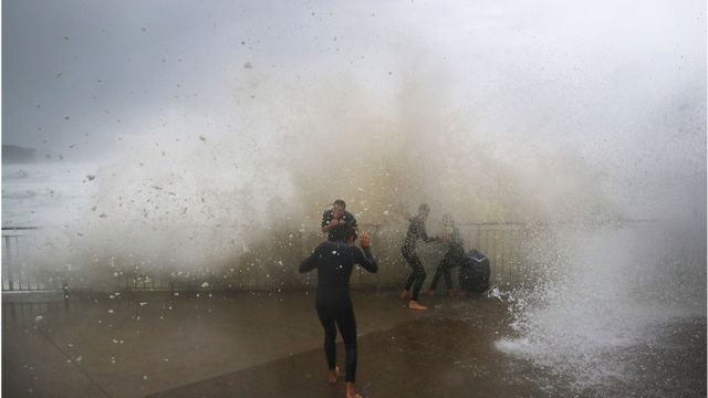 Children are soaked by huge waves at Bronte Beach