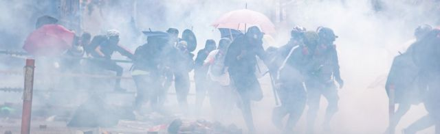 Protesters amid tear gas during the Hong Kong Polytechnic University demonstration