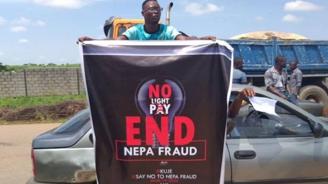 Protester carry banner for Abuja protest