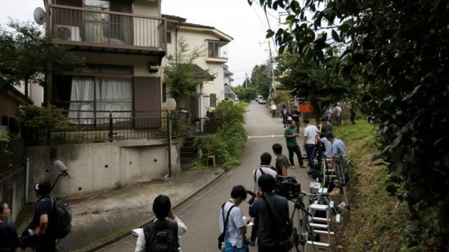 Reporters outside suspect's home in Sagamihara, Japan (26 July 2016)