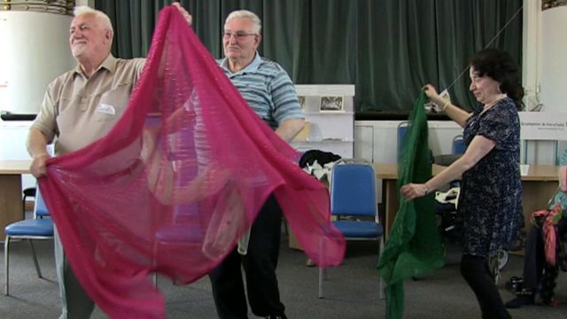 People learning Indian dance in hospital