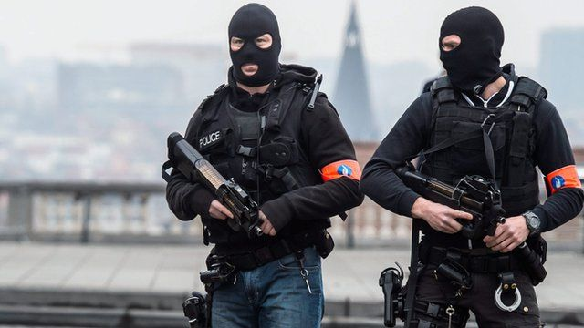 Police officers stand guard outside the court where suspect in the November 13 Paris terrorist attacks Salah Abdeslam was expected to appear, in Brussels, Belgium, 24 March 2016