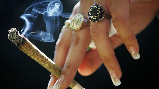 Woman smoking marijuana.