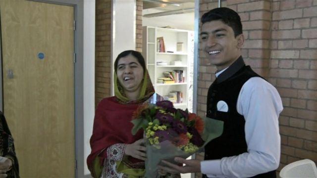 Malala Yousafzai receives flowers from Anwar Ullah