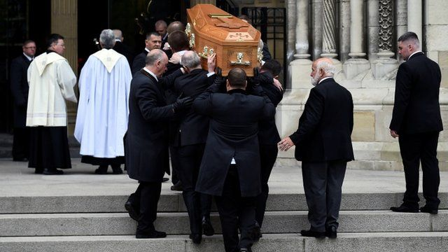Pallbearers carry the coffin of journalist Lyra McKee at her funeral at St. Anne's Cathedral in Belfast