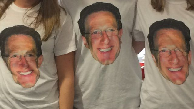 Staff wore T-shirts of their outgoing boss on his final day