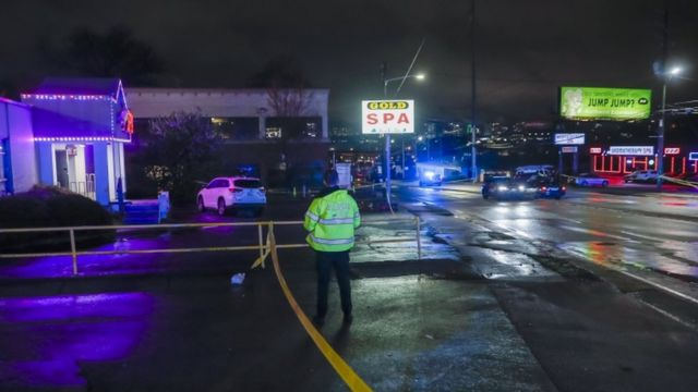 Atlanta Police Department officers investigate the scene of a shooting outside a spa o­n Piedmont Road in Atlanta, Georgia, USA, 16 March 2021