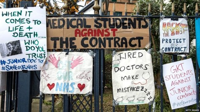 Junior doctors leave posters on gates outside King's College hospital on 27 April 2016
