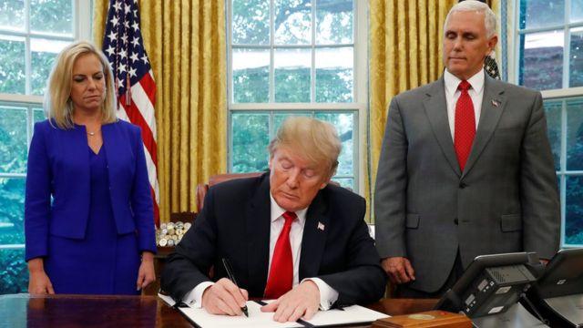 Donald Trump, Mike Pence na Kirstjen Nielsen bụ onye na-ahụ maka ime obodo
