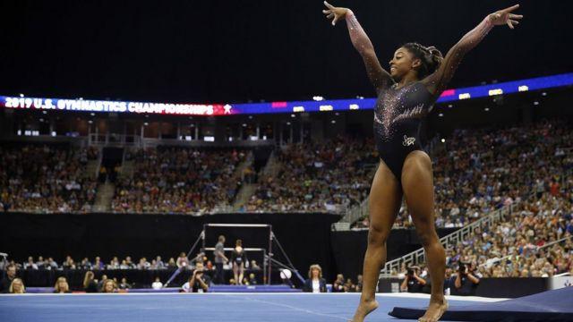Simone Biles competes on floor exercise