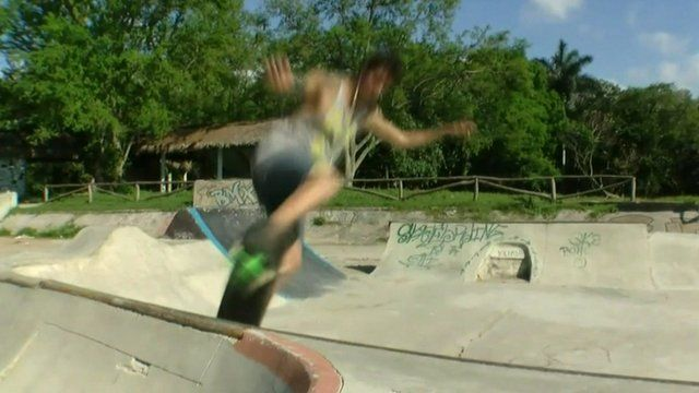 Skater approaching the lip of a ramp at the park frontside