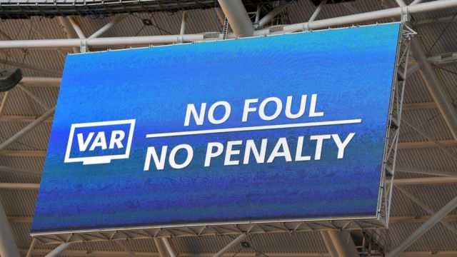 A screen at a football stadium reads 'No foul, no penalty'