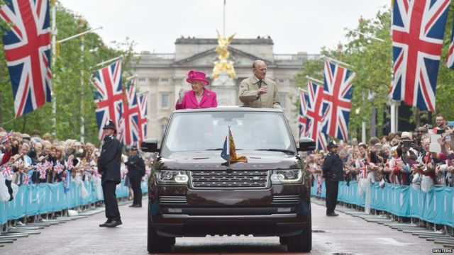 The Queen and Prince Philip travel down The Mall