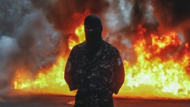 Protester in front of burning tyres, Kiev