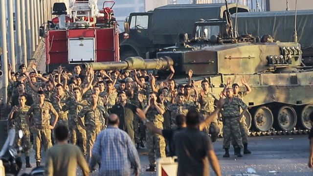 Soldiers involved in the coup surrender on the bridge over the Bosphorus in Istanbul (16 July)