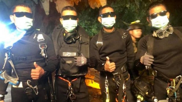 A handout photo made available by Thai Navy Seal Facebook page on 10 July 2018 shows the last four of Thai Navy Seals members, who stayed with the boys and their coach inside a cave until they all were rescued, at the Tham Luang cave in Chiang Rai province, Thailand