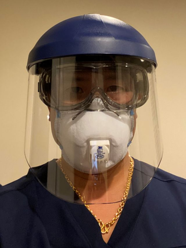 Dr Edward Chew wearing a visor and protective mask