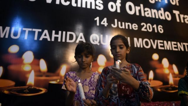 Pakistani young supporters of Muttahida Qaumi Movement (MQM) light candles in Karachi on June 14, 2016, to pay tribute for the victims of the Orlando shooting in Florida