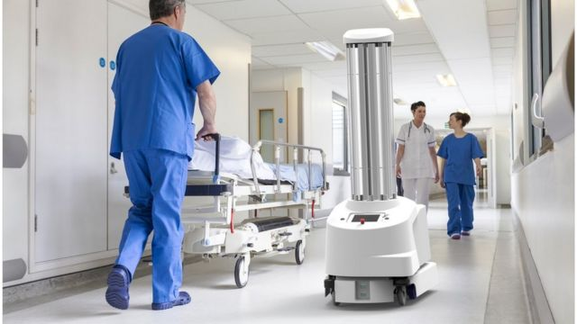 cleaning robots in a hospital hallway