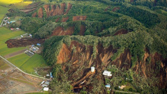 Big landslides engulfing houses and roads