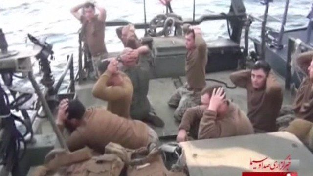 Still from video showing captured US Navy servicemen