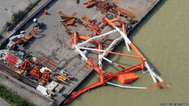 a crane that toppled due to strong winds in Nishinomiya city, Hyogo prefecture on September 5, 2018, after typhoon Jebi hit the west coast of Japan.