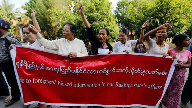 Locals protest against former U.N. Secretary-General Kofi Annan, who is visiting in his capacity as the Myanmar government-appointed Chairman of the Advisory Commission on Rakhine State, near Sittwe airport, Rakhine state, Myanmar December 2, 2016.