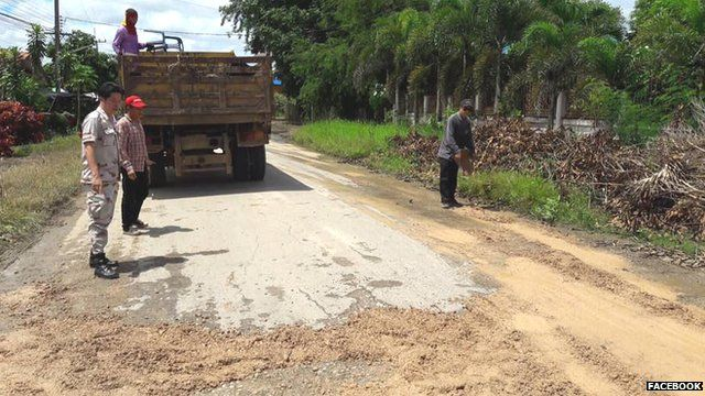 Potholes being repaired in Thailand