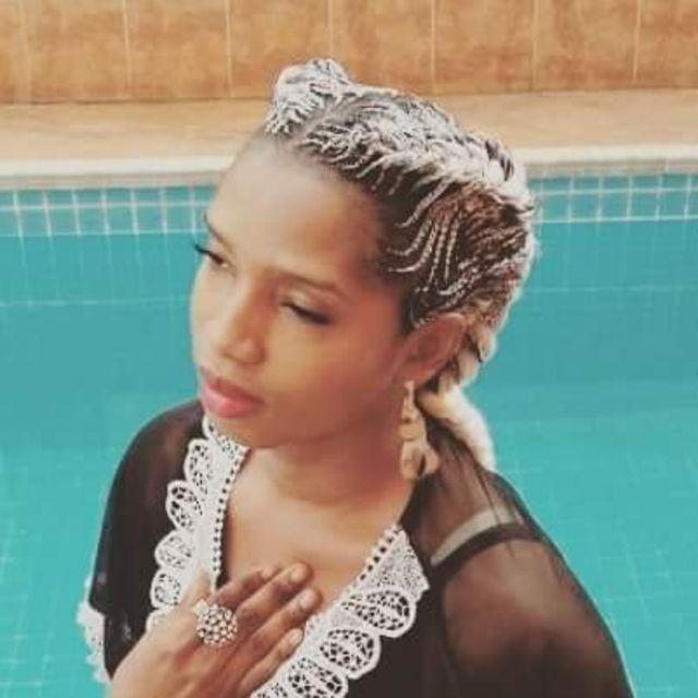 Mystique Evolving as she pose near swimming pool