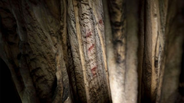 Scientists say the signs of three caves in Spain are unnatural.
