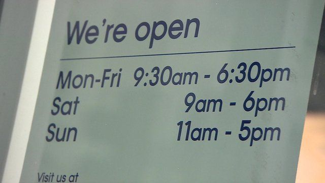 An opening hour sign in a shop