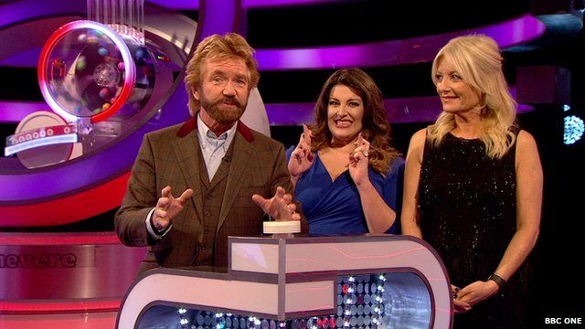 Noel Edmonds prepares to push the lottery draw button