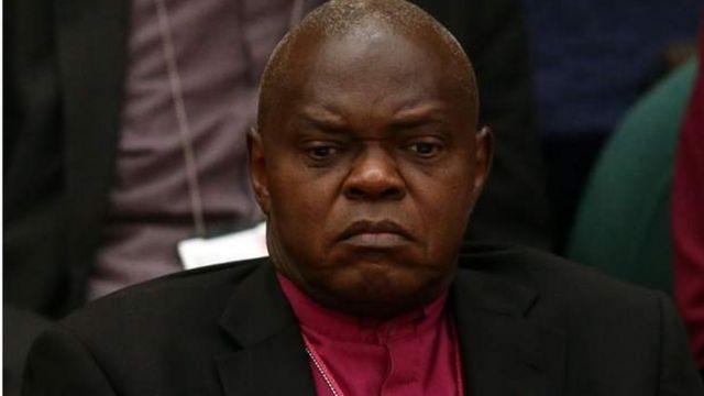 Dakta Santamu ya tsere Uganda a 1974 kuma ya zama babban limamin coci a 2005
