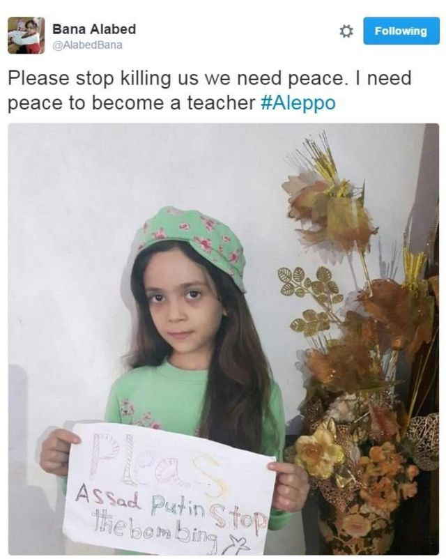 Tweet from @alabedbana, showing Bana holding a handwritten sign which says: Please Assad Putin stop the bombing.