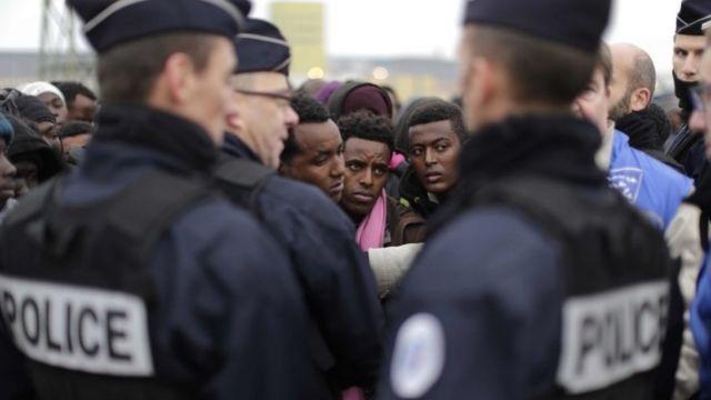 Migrants queue for Jungle reception points
